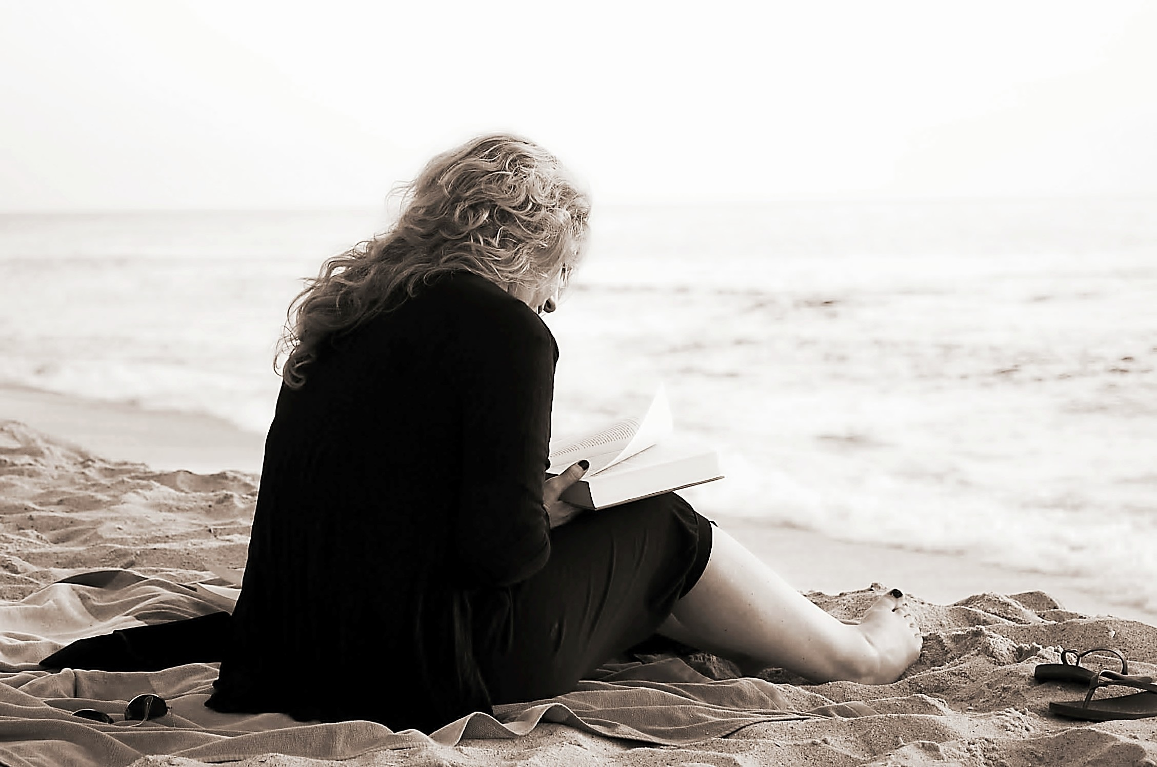 Women read book on the seashore